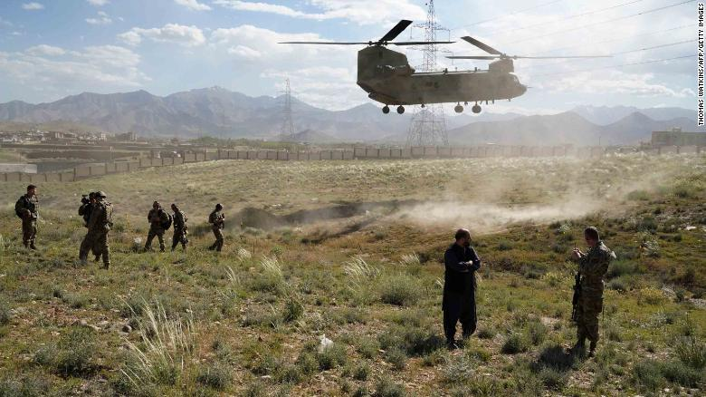 In this photo taken on June 6, 2019, a US military Chinook helicopter lands on a field outside the governor's palace during a visit by the commander of US and NATO forces in Afghanistan, General Scott Miller, and Asadullah Khalid, acting minister of defense of Afghanistan, in Maidan Shar, capital of Wardak province. - A skinny tangle of razor wire snakes across the entrance to the Afghan army checkpoint, the only obvious barrier separating the soldiers inside from any Taliban fighters that might be nearby. (Photo by THOMAS WATKINS / AFP) / To go with 'AFGHANISTAN-CONFLICT-MILITARY-US,FOCUS' by Thomas WATKINS        (Photo credit should read THOMAS WATKINS/AFP/Getty Images)